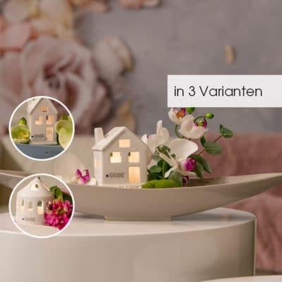 Dekoset Vapiano dekoriert mit LED Haus und Orchideen